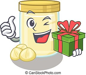 Happy macadamia nut butter character having a gift box
