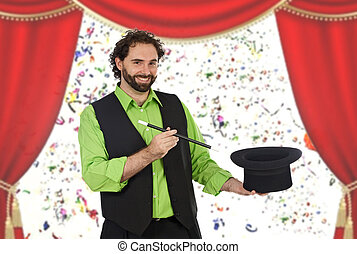Happy magician with his barite in the theater with a red curtain