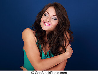 Happy makeup woman hugging herself with natural emotional enjoying face. Love concept of yourself body