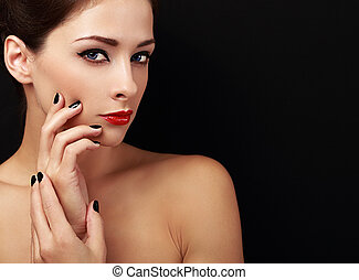 Happy makeup woman looking with red lips and black fingers on black