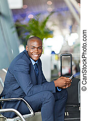 happy male african business traveler