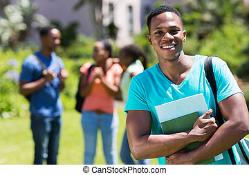 male african college student holding books