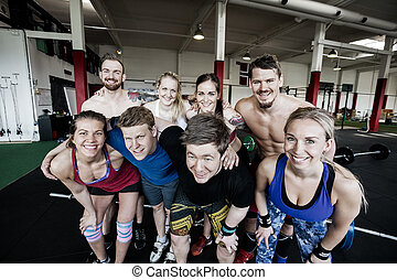 Happy Male And Female Friends In Gym