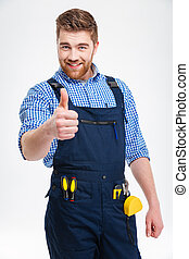Happy male builder showing thumb up isolated on a white...