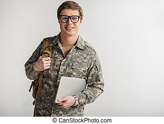 Happy male cadet is ready for classes
