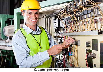 technician repairing industrial machine - happy male...