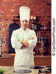 happy male chef cook in restaurant kitchen