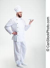 Happy male chef cook standing with plate