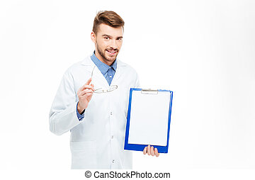 Happy male doctor showing blank clipboard