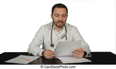 Happy male doctor with thumbs up on white background