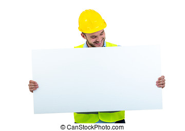 Happy male engineer holding an advertisement blank banner. Isolated on white background