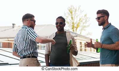 happy male friends drinking beer at rooftop party - leisure,...