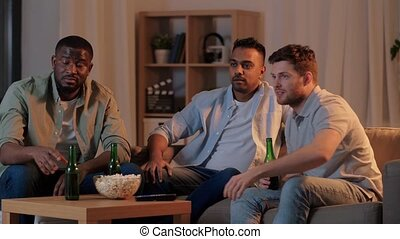 happy male friends with beer watching tv at home - ...
