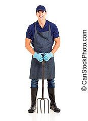 male gardener with a garden fork