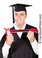happy male graduate on white background