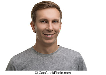 Happy male in simple gray t-shirt isolated portrait