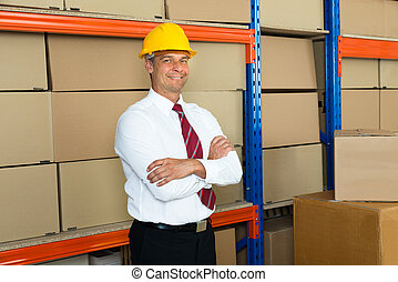 Happy Male Manager With Arms Crossed