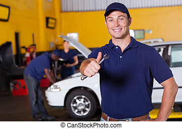 happy male mechanic giving thumb up - happy male auto...