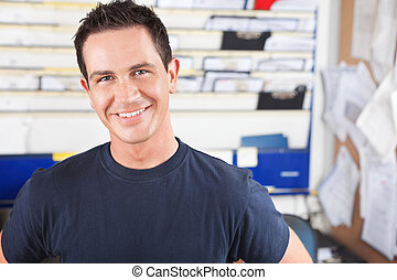 Happy Male Mechanic - Portrait of a happy mechanic looking ...