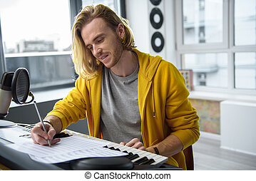 Happy male musician creating new Hit