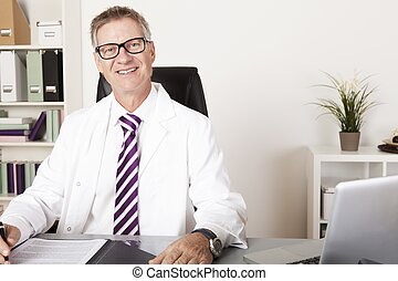 Happy Male Physician Looking at Camera