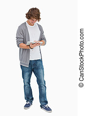 Happy male student using a touch pad