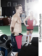 Happy Male Trainer Standing In Gym