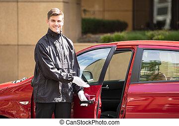 Happy Male Valet Opening Car Door - Portrait Of A Happy...