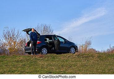 Happy man and his car