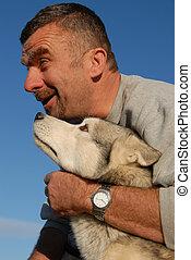 happy man and husky