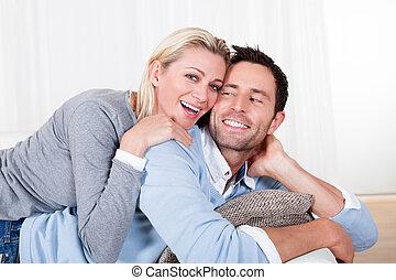 Happy man and woman cuddling