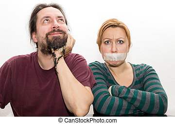 man and woman with ban on speaking