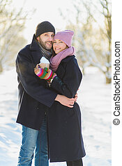 Happy man and woman. Young Couple On Winter Vacation