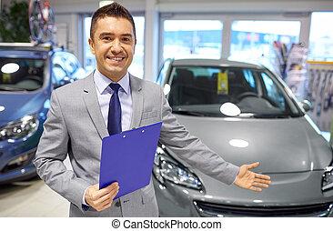 happy man at auto show or car salon