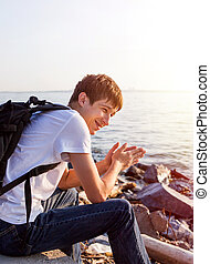 Happy Man at Seaside - Happy Young Man on the Sea Background