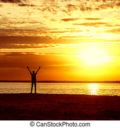 Happy Man at Sunset - Happy Man Silhouette with Hands Up on...