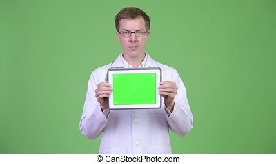 Happy Man Doctor Showing Chroma Key Green Screen Digital Tablet