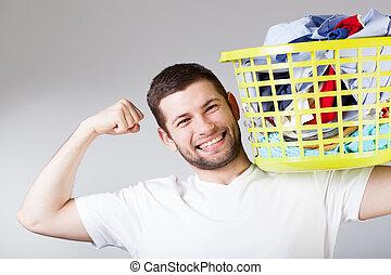 Happy man doingg laundry