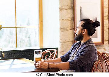 happy man drinking beer at bar or pub