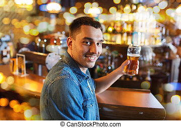 happy man drinking beer at bar or pub - people, drinks,...