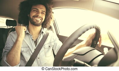 Happy man driving car retro look
