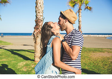 Happy man embracing his girlfriend smiling outside