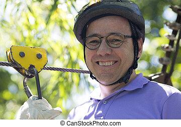 Happy Man Enjoying Zip Adventure