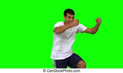 Happy man gesturing on green screen