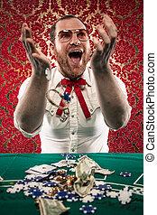 Happy Man Gets Rich at Blackjack - A man wearing glasses, a...