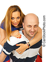 Happy man giving piggy back ride to woman