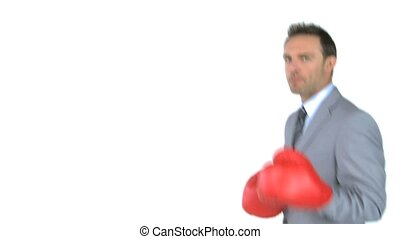 Happy man giving punches with boxing gloves in front of the...