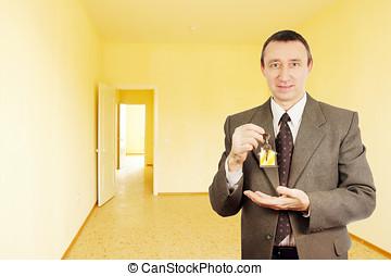 Happy man got a key of new apartment