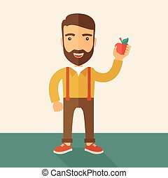 Happy man holding a red apple.