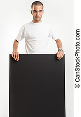 Happy man holding blackboard